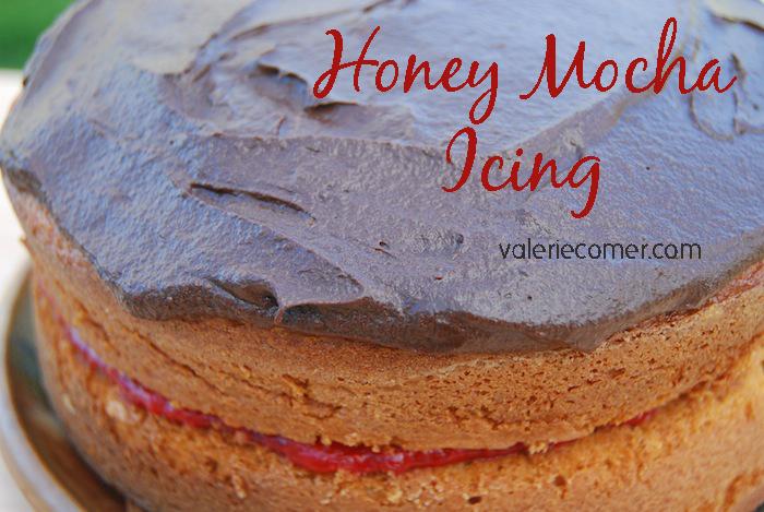 Honey Mocha Icing shown on strawberry cake